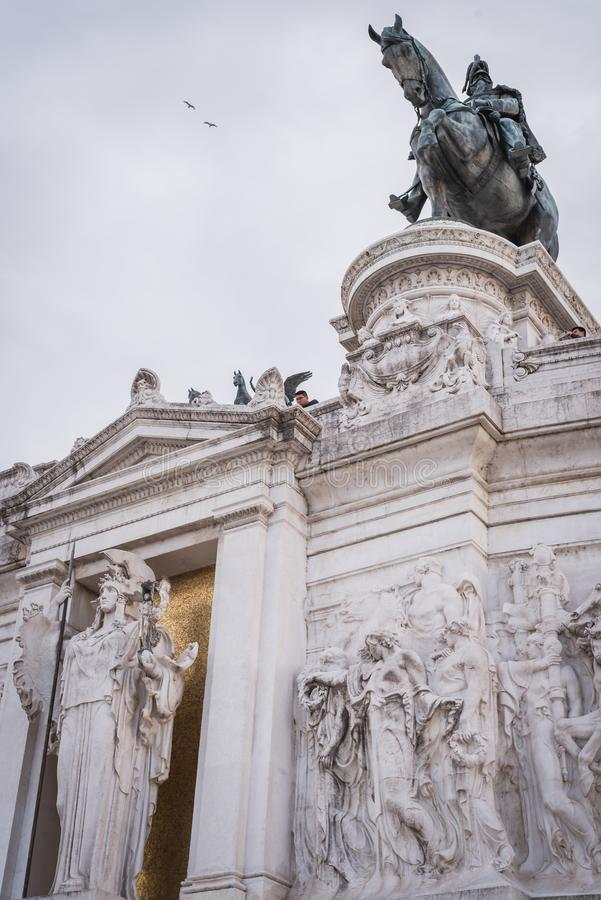 Details of the Monument to Vittorio Emanuele II with the Italian flag in Rome royalty free stock images