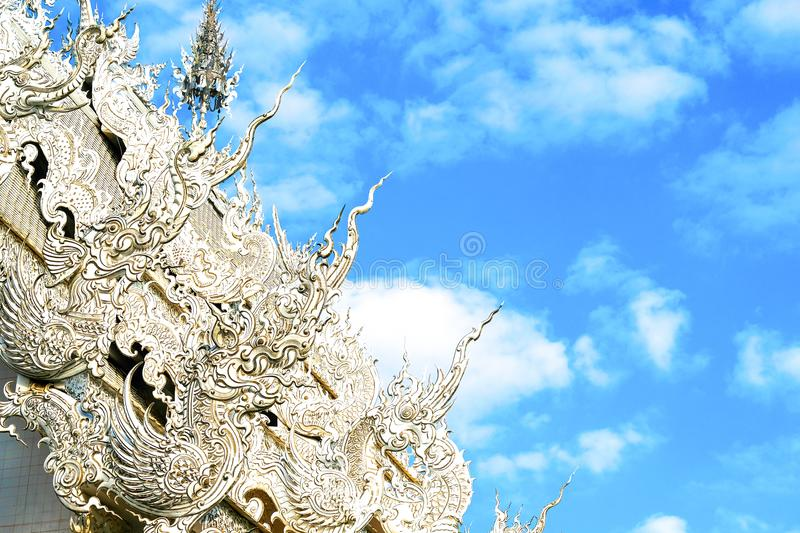 Elaborate details of a Thai temple roof. Details of Northern Thai Buddist temple roof with imaginative mystical creatures, elaborate stucco style royalty free stock photos