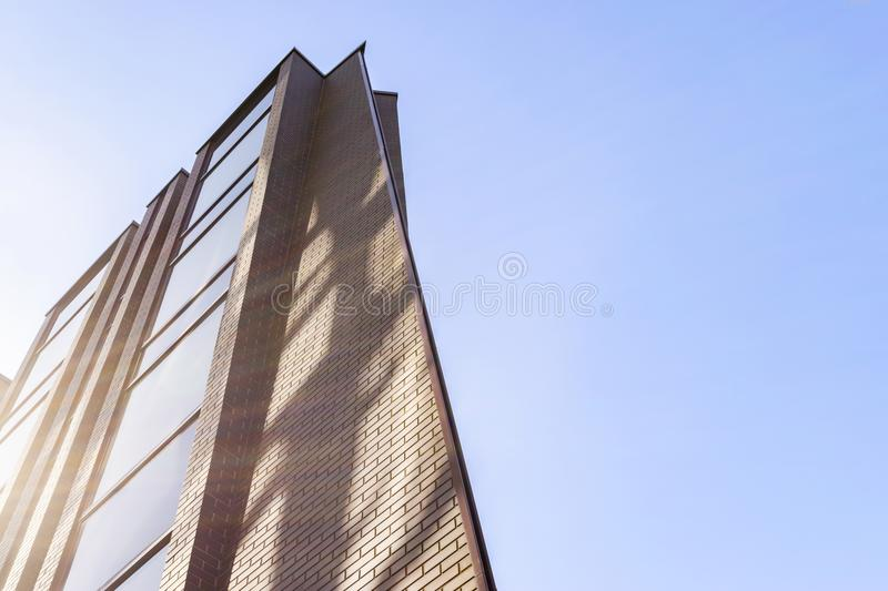 Details of office building exterior. Business buildings skyline looking up with blue sky. Modern architecture apartment. High tech. Exterior. Reflective stock images