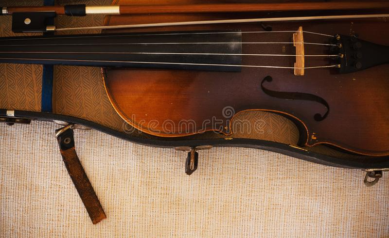 Old Violin From Czechoslovakia. Details of an old and dusty violin from Czechoslovakia royalty free stock photos