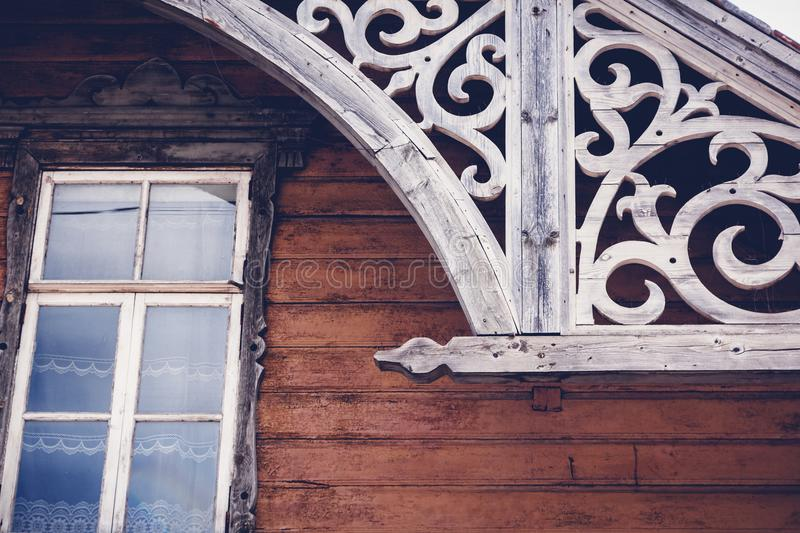 Details of the old historical wooden architecture, Rakvere, Estonia. Traditional house with carved wooden details stock photo
