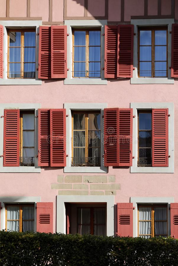 Windows of Pink Old Building in Switzerland royalty free stock photography