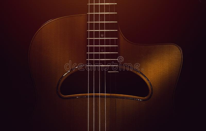 Old Gypsy Acoustic Guitar. Details of old retroacoustic guitar, gypsy jazz in style of Django royalty free stock photography