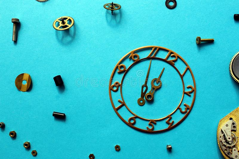 Details of old watches are scattered on the table stock image