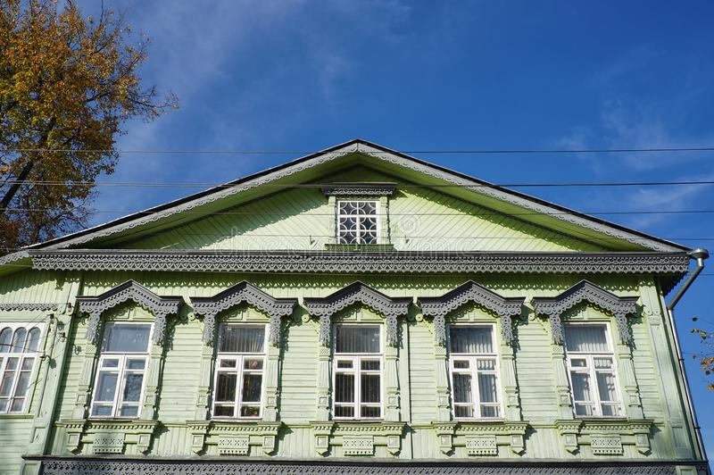 Details of the old wooden house with traditional carved window frames in the historical center of Tver city royalty free stock photo