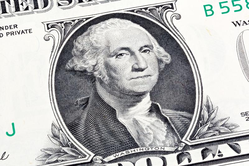 Details of a one dollar bill, George Washington in foreground. S royalty free stock images