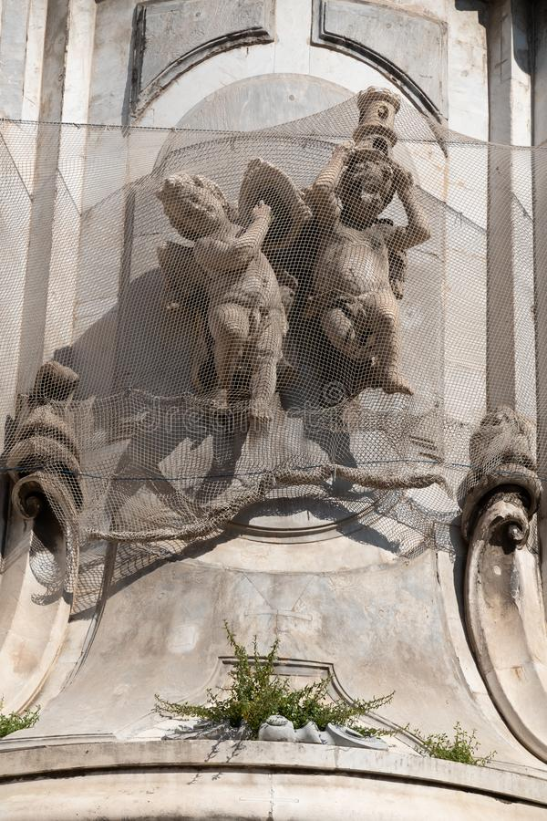 Details in Piazza del Gesu, Naples. Details in  Gesù Nuovo square in Historical center of Naples italy angels architecture art ashlar baroque building stock image