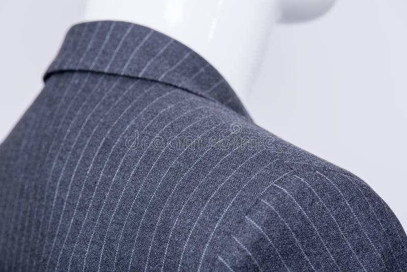 Details on the pinstripe suit coat. On mannequin stock images