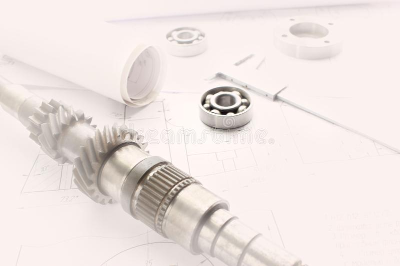 Details after processing lies on the technical drawing, ready to work with the drawing in mechanical engineering, vignette royalty free stock photo
