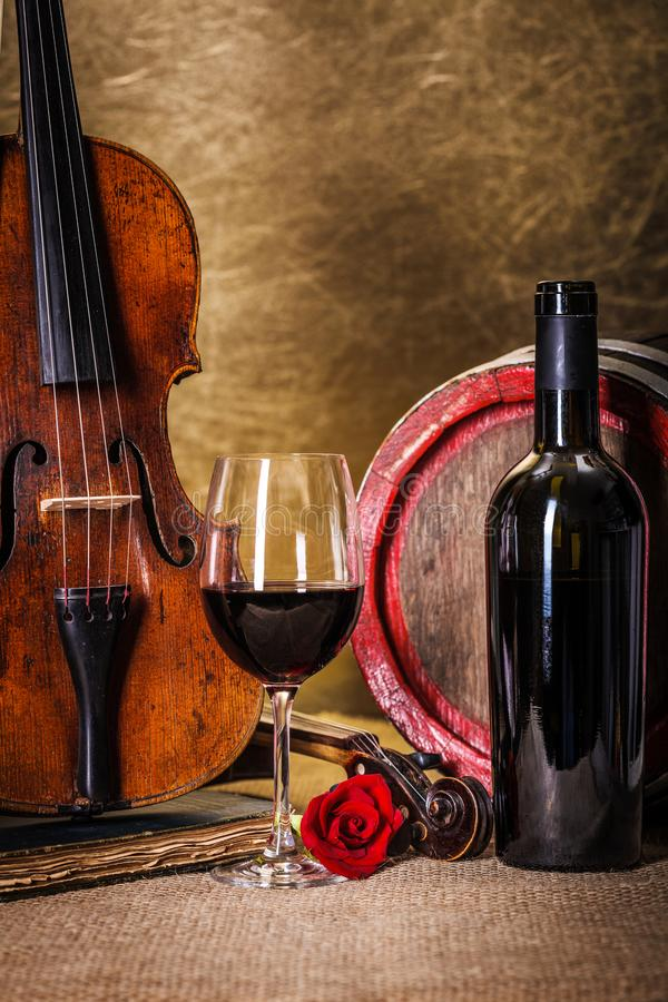 Red wine in glass, barell and violin stock photos
