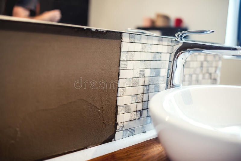 Details of renovation works. Bathroom details with mosaic tiles and cement adhesive royalty free stock images