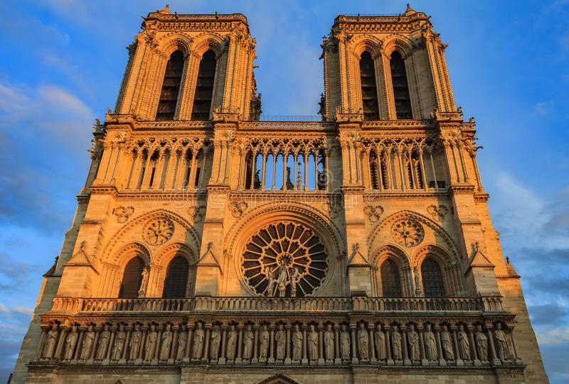Details of the western facade of Notre Dame de Paris Cathedral facade with the oldest rose window and ornate tracery in the warm. Details of the main facade of stock photography
