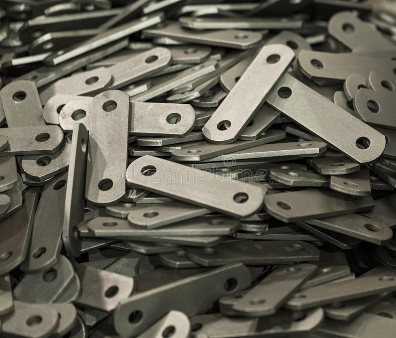 Details of steel plate is manufactured by punching press in the royalty free stock image