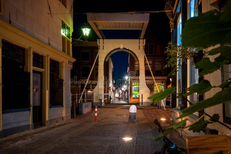 Authentic Dutch white drawbridges over city canals in an old cit stock photos