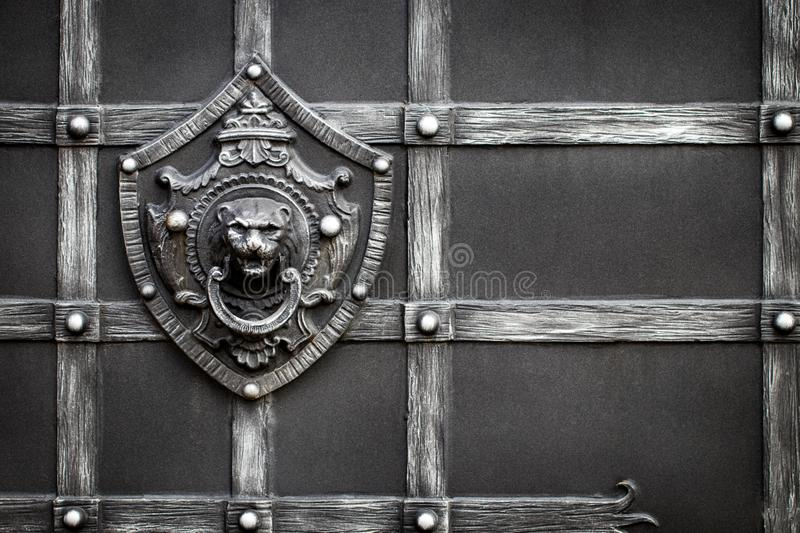 Details, structure and ornaments of forged iron gate. Decorative royalty free stock photo