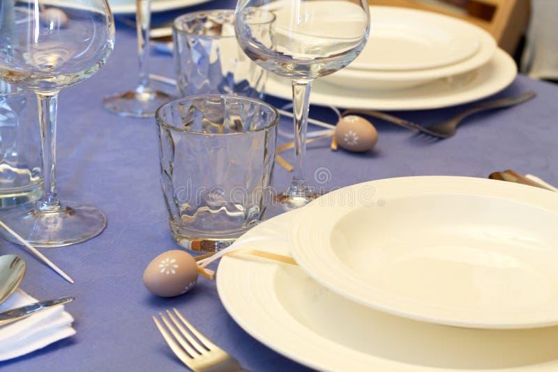 Details of table setting for easter festivity. Details of table setting with dishes and glasses for easter festivity stock photography
