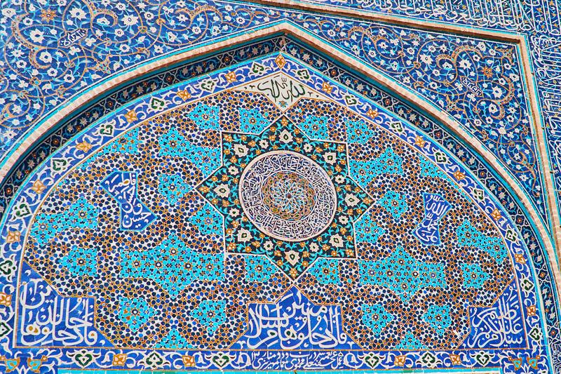 Details of tilework on Jameh Mosque, Yazd, Iran. Details of rich tiled decoration on the portal of Jameh Mosque, the stellar, floral and geometric blue gamma royalty free stock photos