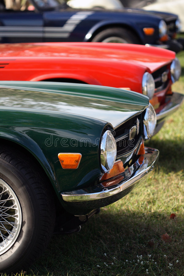 Details of vintage British cars, fender, wheel, and tires royalty free stock images