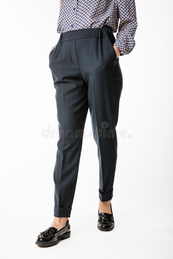 Details of women`s clothing. Women`s pants model. On a white background stock images