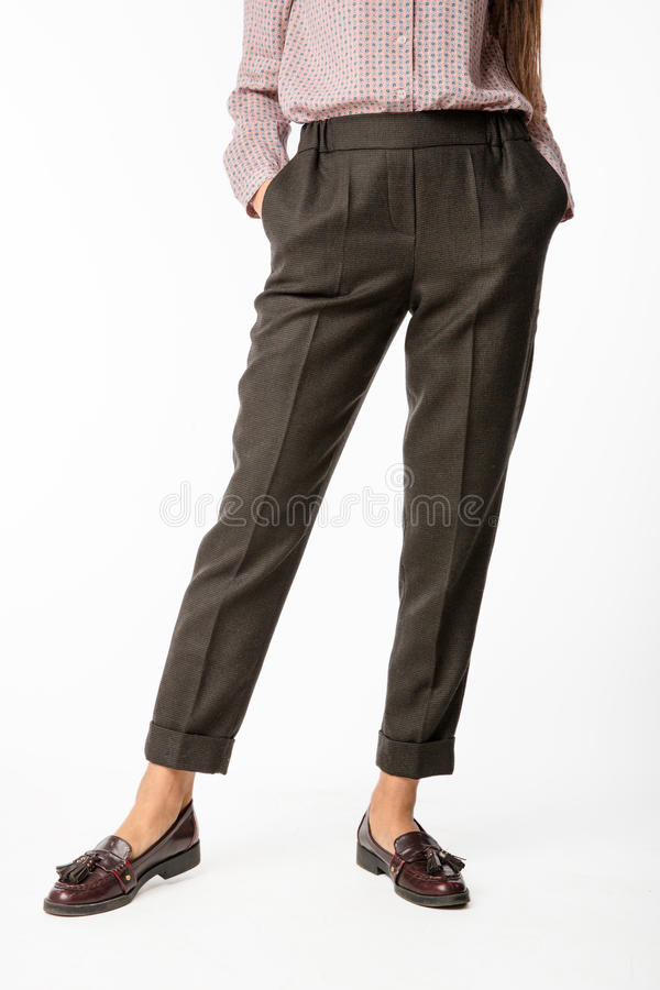 Details of women`s clothing. Women`s pants model. On a white background stock photos