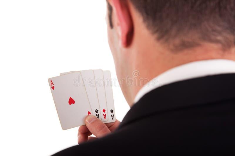 Detalhe da costa de um homem com quatro cartões imagem de stock royalty free