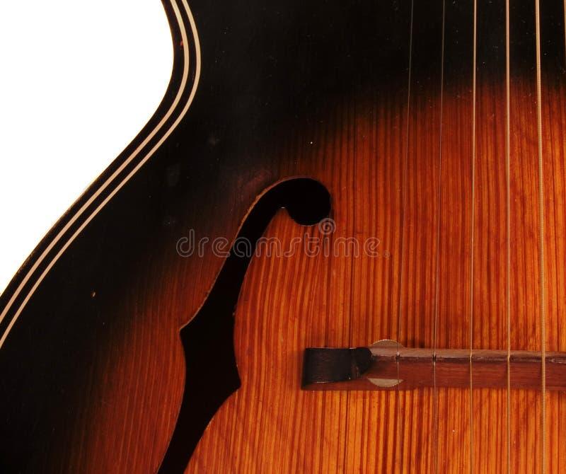 Detalhe da guitarra acústica do furo de Archtop F do vintage fotografia de stock royalty free