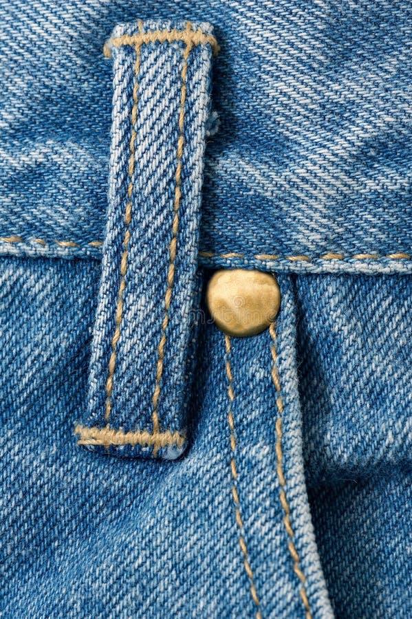 Detalhe das calças de brim da sarja de Nimes foto de stock royalty free