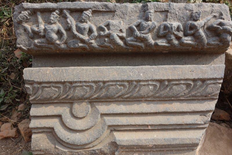 Detalhe de cinzeladura de pedra antigo de Nalanda fotografia de stock