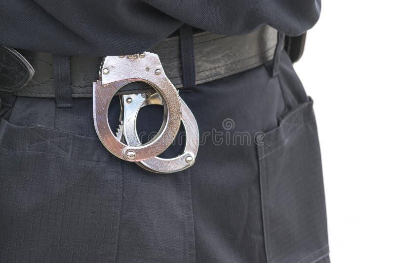 Detalhe de correia de serviço público do agente da polícia com punhos imagens de stock royalty free