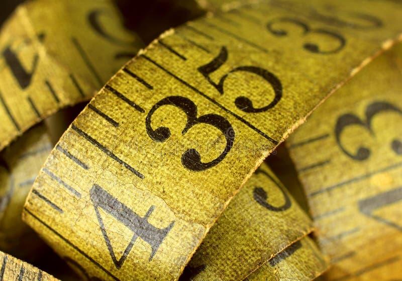 Fita métrica velha fotografia de stock royalty free