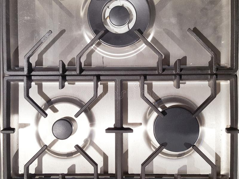 Detalhe de queimadura do close up do fogão de cozinha do queimador de gás fotos de stock