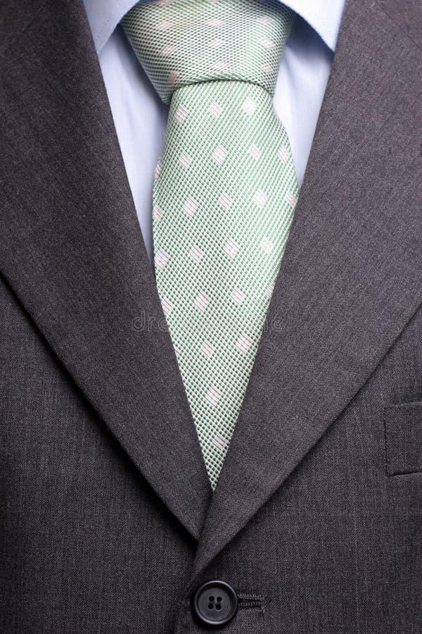 Detalhe de um terno e de um laço fotos de stock