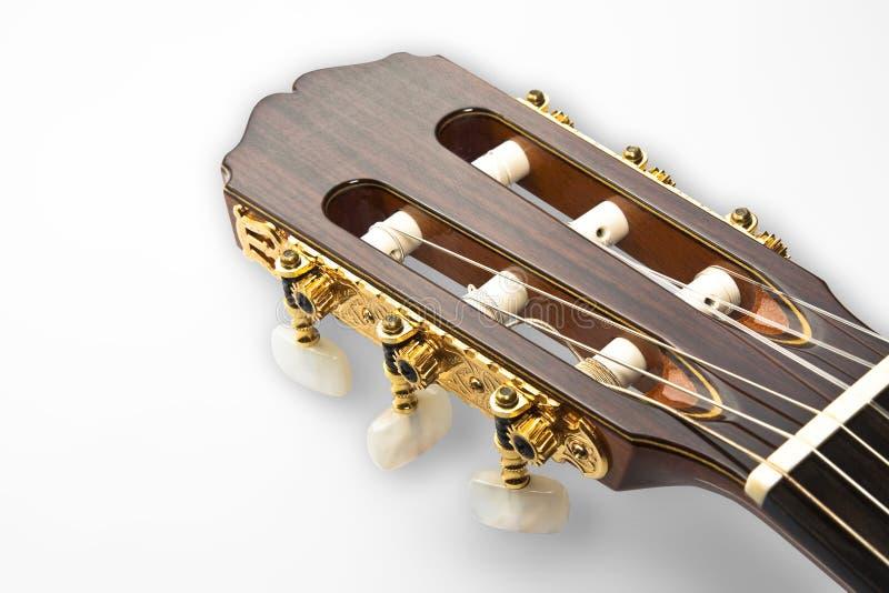 Detalhe de uma pá dourada de uma guitarra clássica profissional fotografia de stock
