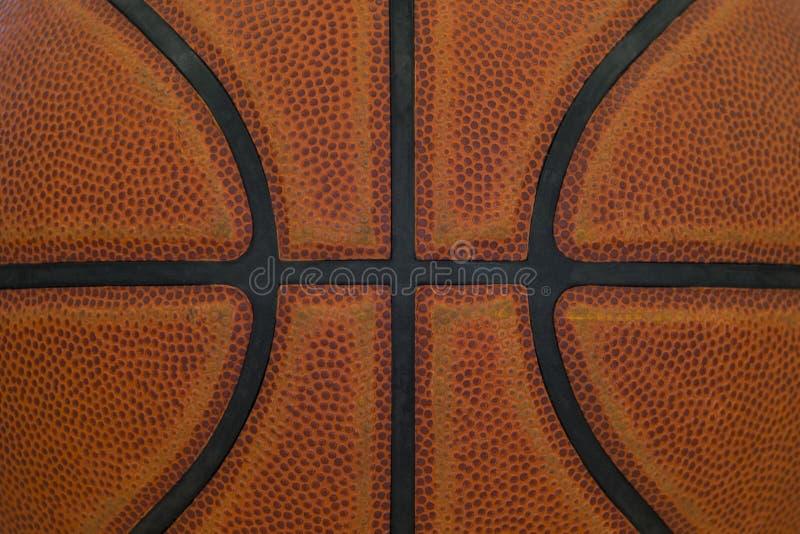 Detalhe do close up de fundo da textura da bola do basquetebol foto de stock