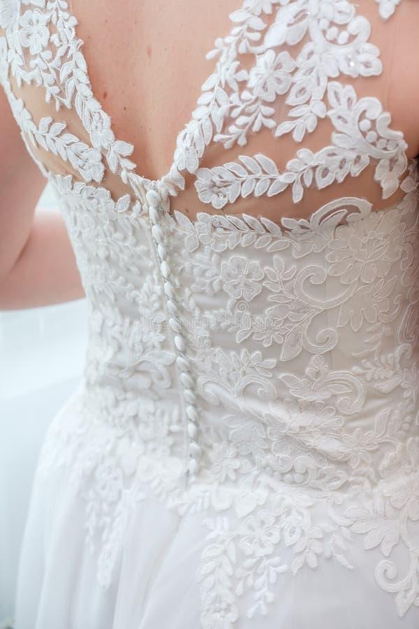 Detalhe do vestido da noiva imagens de stock royalty free