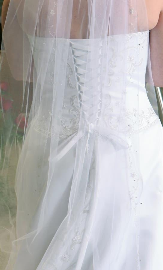 Detalhes da parte traseira do vestido nupcial imagens de stock