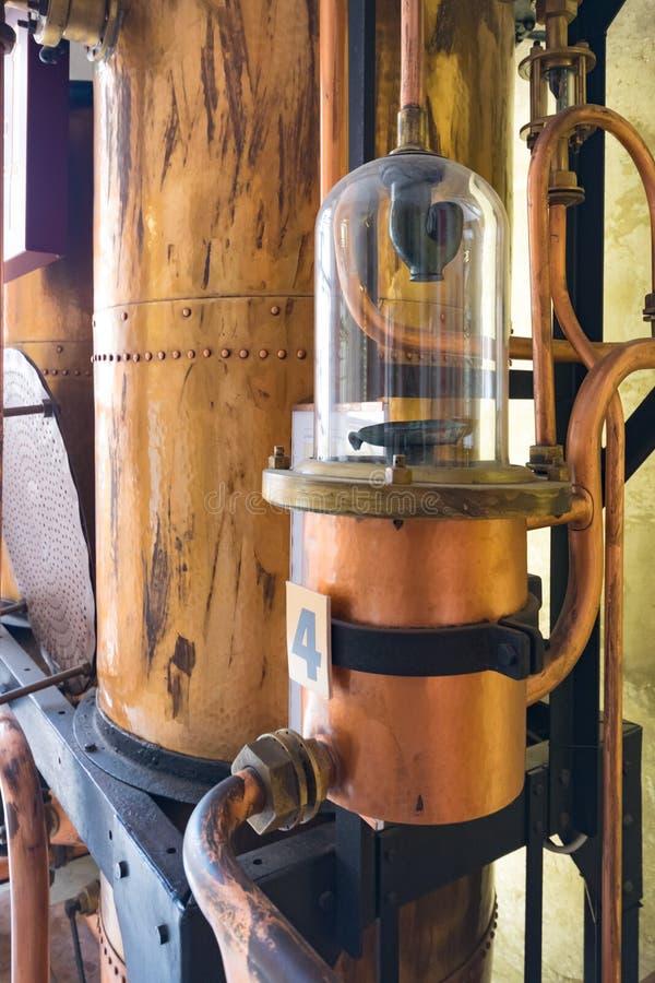 Detalhes das ferramentas de cobre usadas para destilar a aguardente fotografia de stock royalty free