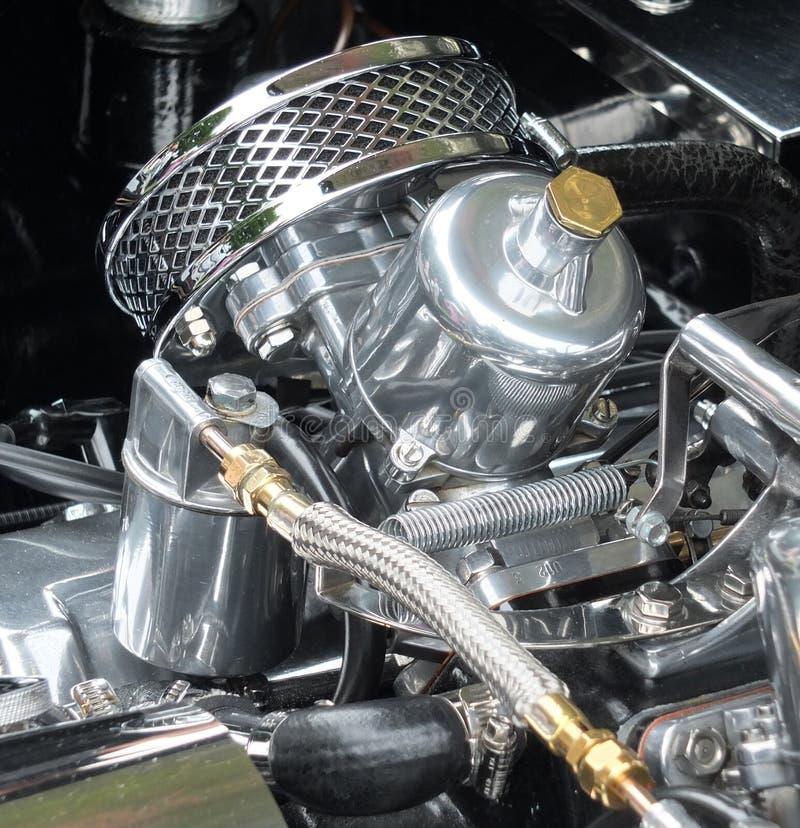 Detalhes de um motor de automóveis lustrado brilhante dos esportes do vintage imagem de stock royalty free