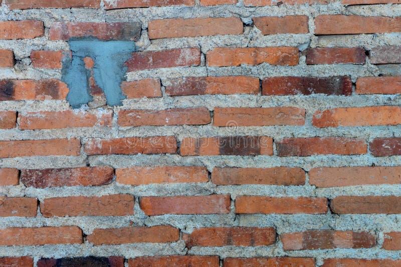 detalj av den gamla tegelstenväggen, texturgrungetappning royaltyfri bild