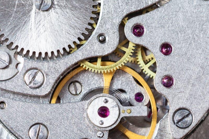 Detalj av det mekaniska klockaslutet upp royaltyfri fotografi
