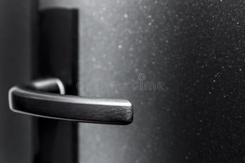 Detalj av ett metalliskt handtag royaltyfria foton