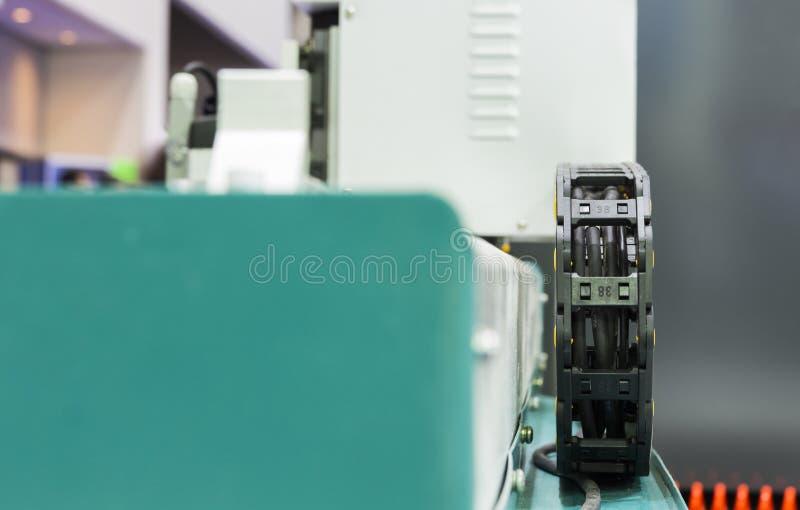 detalj för mekanism för böjligt magasin för makttraktråd rörande fotografering för bildbyråer