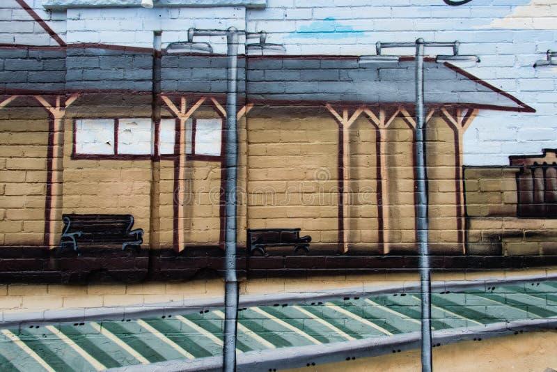 Detalj från en väggmålning på en tegelstenvägg 1 arkivbild