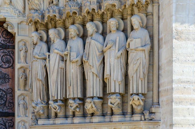 Detaljer av fasaden av domkyrkan av Notre Dame de Paris, Frankrike royaltyfria bilder
