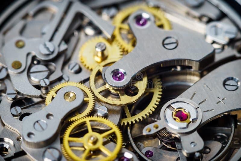 Detaljer för tappningklockadel av chronographrörelse arkivbilder