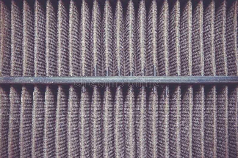 Detaljerat fragment av smutsig yttersida för luftfilter royaltyfri foto