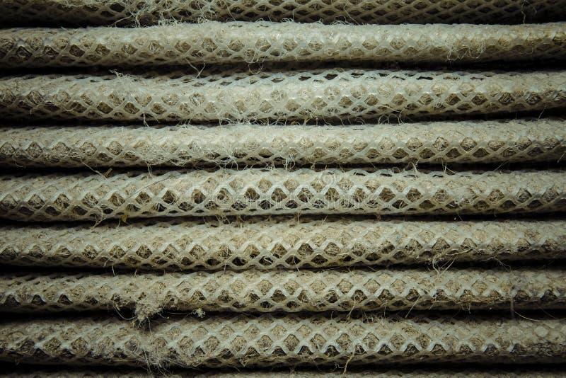 Detaljerat fragment av smutsig yttersida för luftfilter royaltyfri fotografi