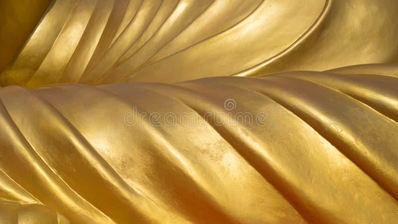 Detalle amarillo dorado metal tallado en estatuas de Buda talladas textura de fondo abstracta imagen de archivo libre de regalías