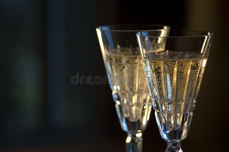 Detalle de dos vidrios de Waterford Champán imagenes de archivo