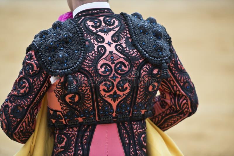 Detalle de la chaqueta del torero. foto de archivo